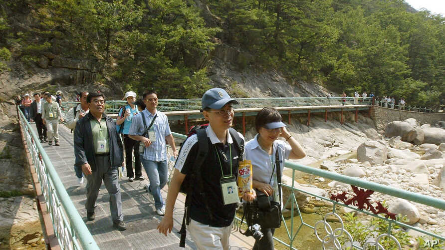 FILE - South Korean tourists visit Mount Kumgang in North Korea, June 15, 2004; the tour program, a rare source of hard currency for cash-strapped North Korea, has been suspended since 2008.