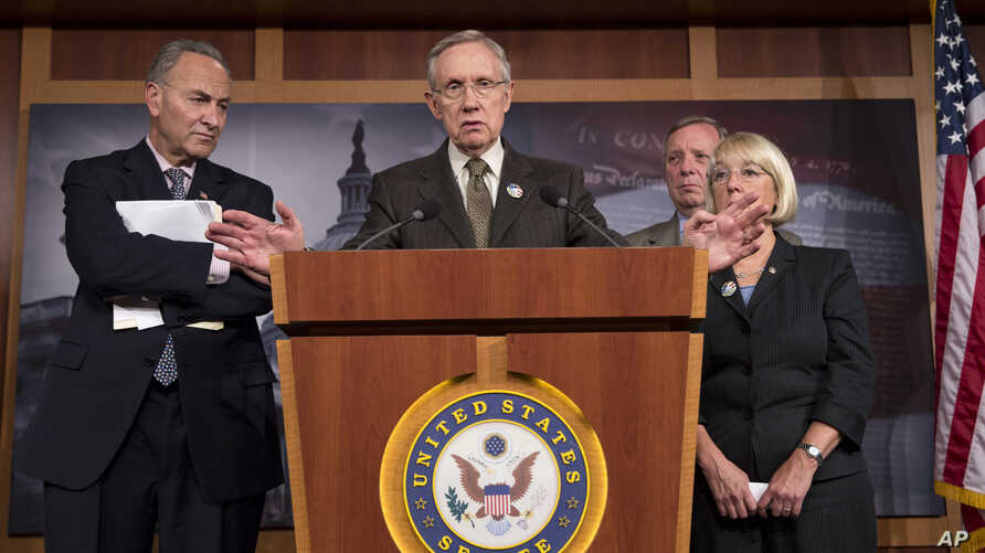 Senate Majority Leader Harry Reid of Nev., center, accompanied by Democratic leaders, gestures during a news conference on Capitol Hill in Washington, Friday, Oct. 4, 2013, where he told reporters that House Speaker  John Boehner of Ohio, and House R