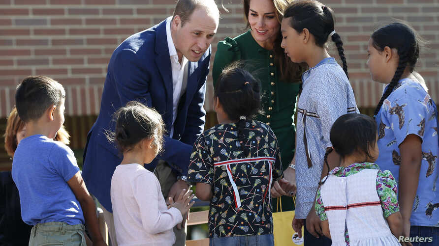 Britain's Prince William and Catherine, Duchess of Cambridge, receive gifts from aboriginal children during a ceremony at the University of British Columbia Okanagan in Kelowna, Sept. 27, 2016.