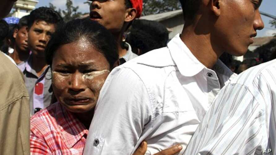 A woman hugs her son who came out of Burma's Insein prison in Rangoon, Burma, January 3, 2012.