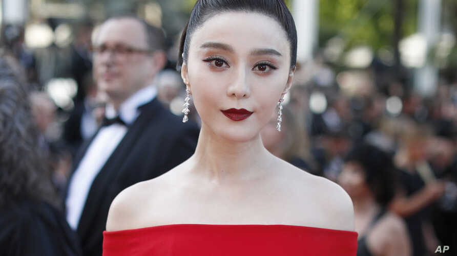 "FILE - Fan Bingbing poses for photographers as she arrives for the screening of the film ""The Beguiled"" at the 70th international film festival, Cannes, southern France, May 24, 2017. Chinese actress Fan has disappeared from social media amid rumors"