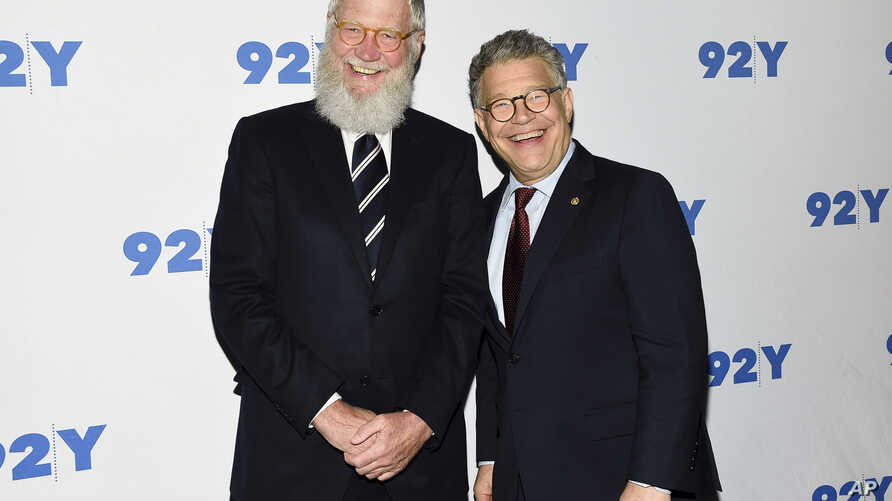 Sen. Al Franken, D-Minn., right, and former talk show host David Letterman arrive for their conversation at 92Y in New York, May 30, 2017.