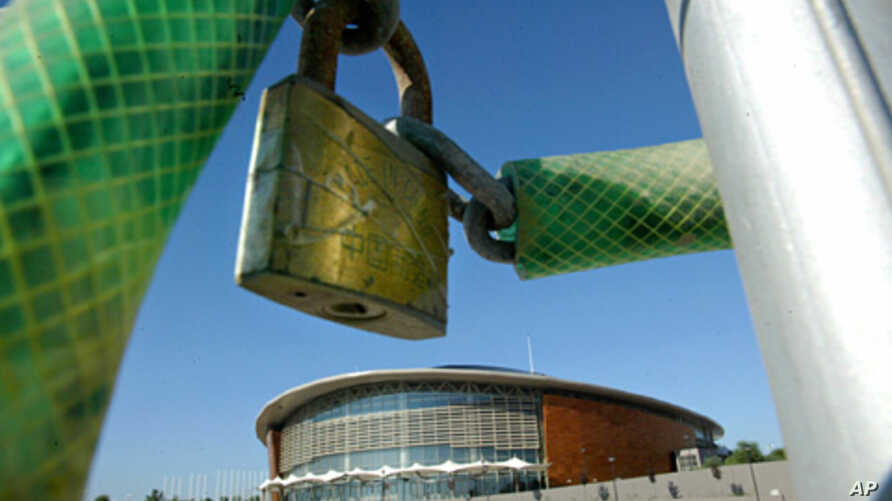 A padlock hangs outside the Tae Kwon Do and Handball stadium at the Faliro Coastal Zone, near Athens, Aug. 8, 2005 (AP).