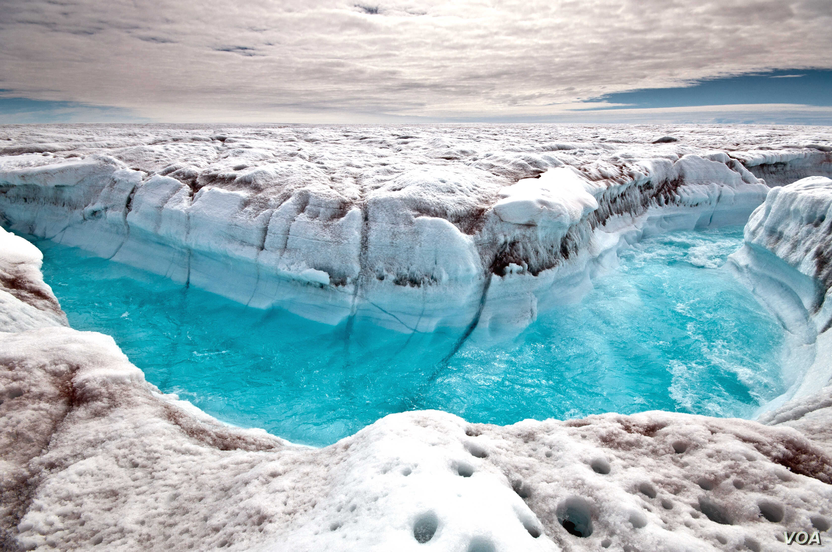 In 2012 polar ice sheets melted at an accelerating rate.  In this photo surface melt water rushes along the surface of the Greenland Ice Sheet through a supra-glacial stream channel. (Ian Joughin)