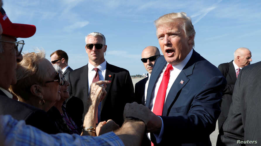 """President Donald Trump greets well-wishers upon his arrival in West Palm Beach Florida, Feb. 17, 2017. Spending the weekend in at his """"Southern White House,"""" Trump on Saturday will hold a rally with supporters in Melbourne, Florida."""