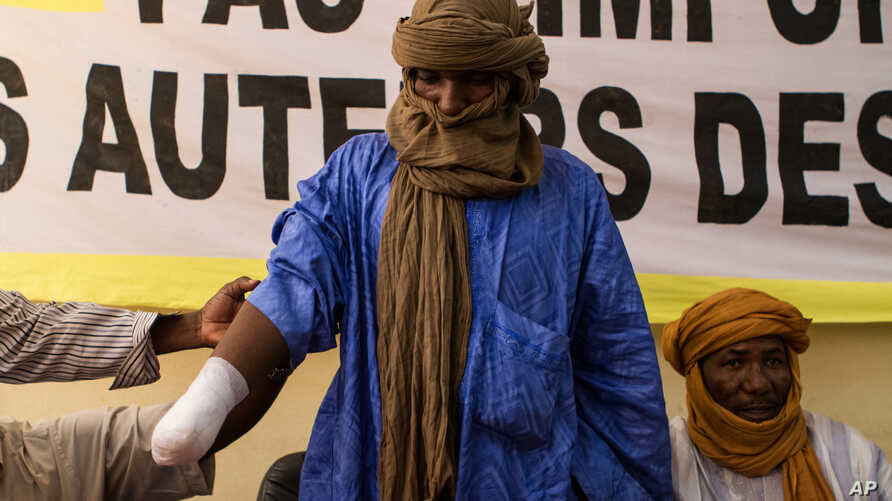 Alhader Ag Almahmoud, a 30-year-old Tuareg herder whose right hand was amputated last month by an Islamist group imposing their interpretation of Shariah, displays his bandaged arm at an Amnesty International press conference in Bamako, Mali, Septemb