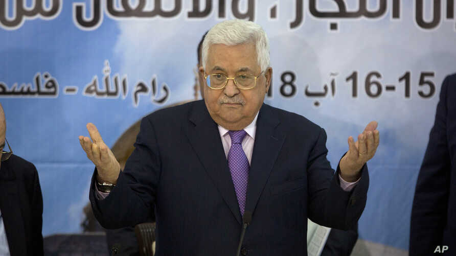 FILE - Palestinian President Mahmoud Abbas, centre, attends a meeting with top decision-making body the Palestinian Central Council, at his headquarters in the West Bank city of Ramallah.