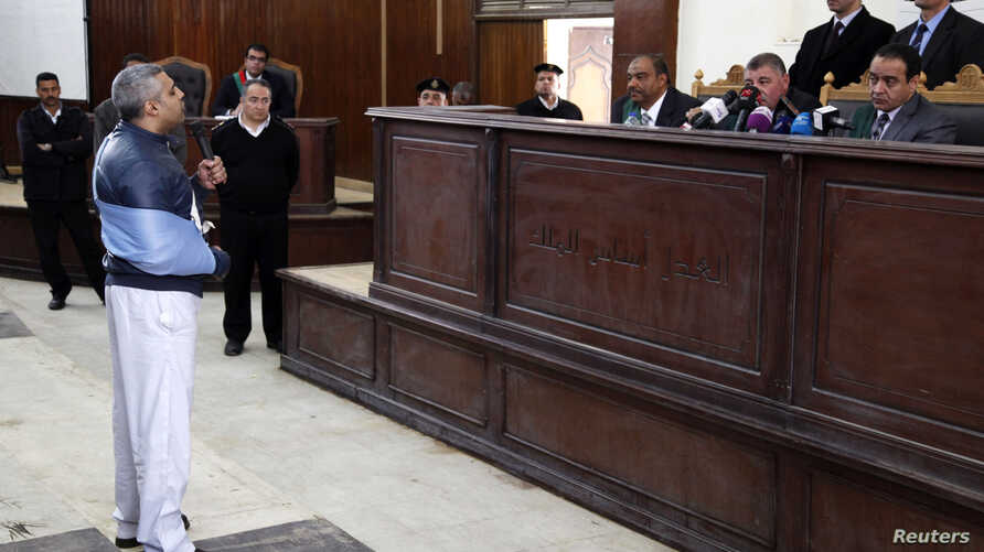 Al Jazeera journalist Mohamed Fahmy speaks before the judge during his retrial at a court in Cairo February 12, 2015. The two remaining Al Jazeera journalists, Mohamed Fahmy and Baher Mohamed, were released from an Egyptian jail on Thursday after mor