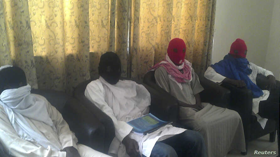 In video, captive says group was abducted by Islamist sect Boko Haram, members of whom are seen below, Maiduguri, Nigeria, Feb. 23, 2013.