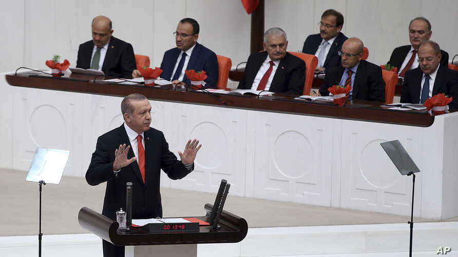 Turkey's President Recep Tayyip Erdogan addresses the parliament during its first session in Ankara, Oct. 1, 2017.