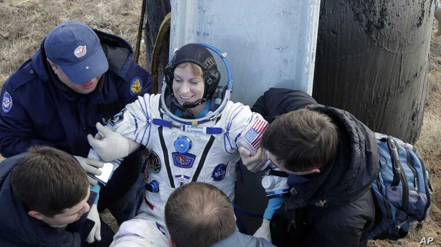 Russian space agency rescue team helps U.S. astronaut Kate Rubins to get from the capsule shortly after landing of the Russian Soyuz MS space capsule about 150 km (90 miles) southeast of the Kazakh town of Dzhezkazgan,  Kazakhstan, Sunday, Oct. 30, 2
