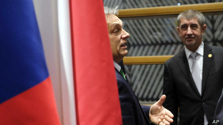Hungarian Prime Minister Viktor Orban, left, speaks with Czech Republic's Prime Minister Andrej Babis during a meeting of the Visegrad Group on the sidelines of an EU summit in Brussels, Dec. 14, 2017.