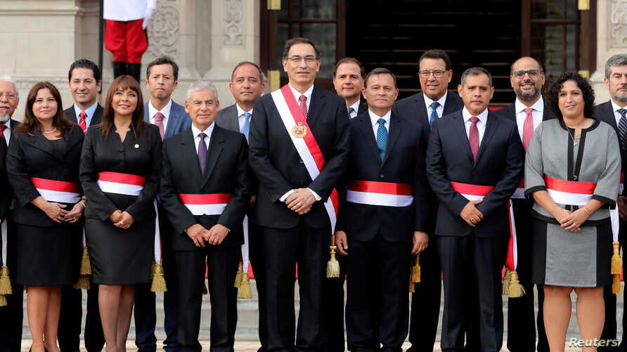 Peru's President Martin Vizcarra, center, and new ministers pose for a picture during their swearing-in ceremony at the government palace in Lima, Peru, April 2, 2018.
