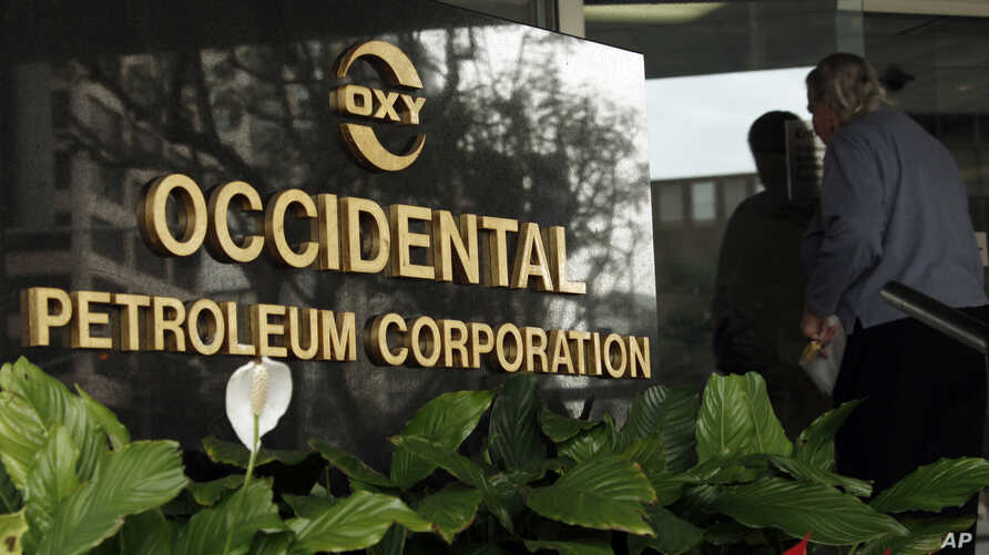 FILE - An employee enters the Occidental Petroleum headquarters in Los Angeles, Jan. 29, 2010.