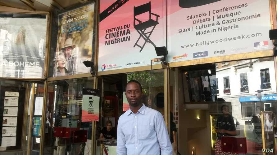 """Serge Noukoue in front of the Paris cinema airing the """"Nollywood Week"""" film festival (Lisa Bryant/VOA)"""