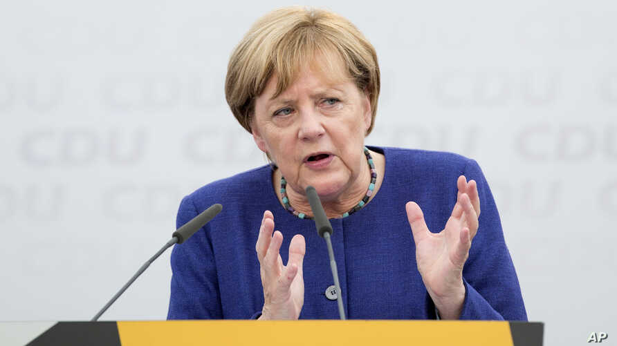 German Chancellor and top candidate of the Christian Democratic Union, CDU, Angela Merkel speaks during an election campaign in Delbrueck, western Germany, Sept. 10, 2017.
