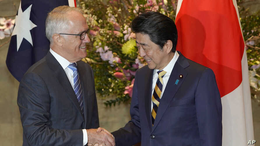 Australian Prime Minister Malcolm Turnbull, left, shakes hands with his Japanese counterpart Shinzo Abe prior to a meeting at Abe's official residence in Tokyo, Jan. 18, 2018.