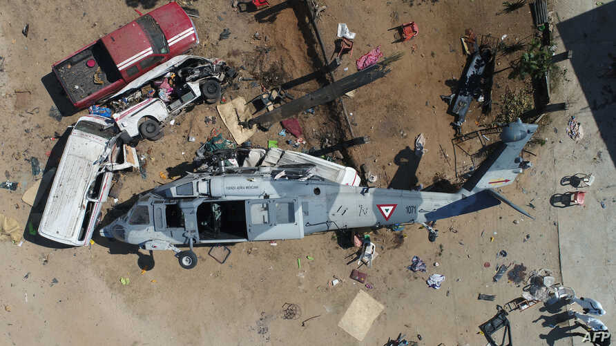 Aerial view of the military helicopter that fell on a van in Santiago Jamiltepec, Oaxaca state, Mexico, on February 17, 2018.