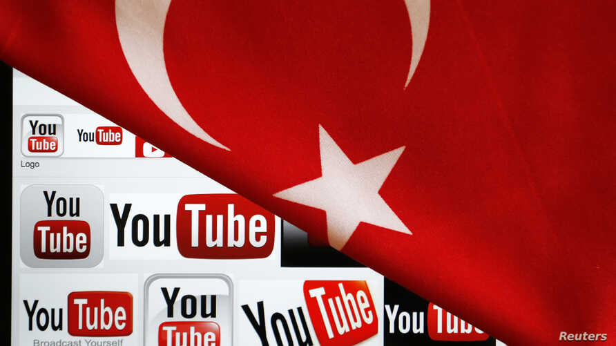 YouTube logos displayed on a laptop screen partially covered with Turkey's national flag in this photo illustration taken in Ankara March 27, 2014.  Turkish Prime Minister Tayyip Erdogan described the leaking on YouTube on Thursday of a recording of