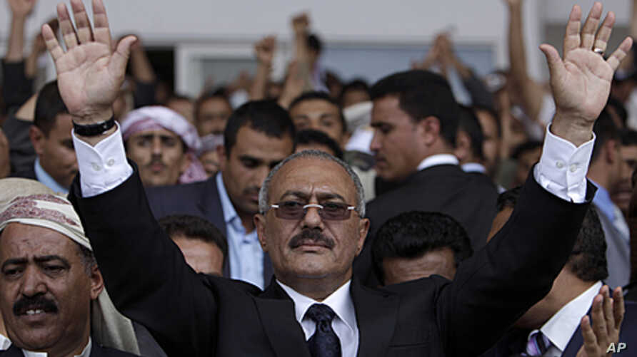 Yemeni President Ali Abdullah Saleh waves to his supporters, not pictured, during a rally in Sana'a, April 15, 2011