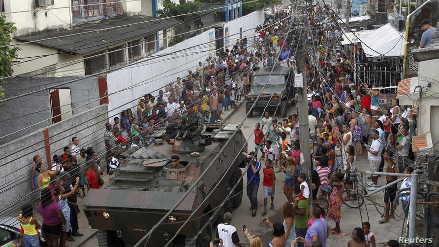 File -- Army soldiers in an armored vehicle leave the City of God slum after the visit by U.S President Barack Obama in Rio de Janeiro on March 20, 2011.