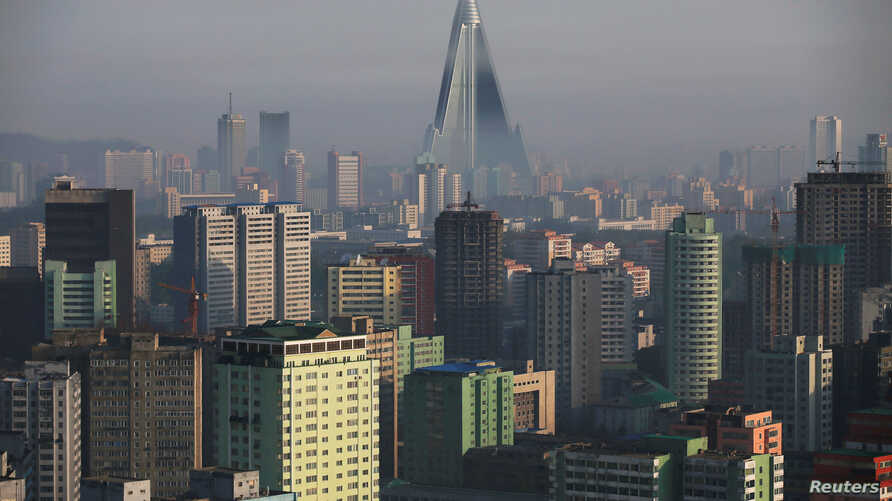 FILE - The 105-story Ryugyong Hotel, the highest building under construction in North Korea, is seen behind residential buildings in Pyongyang, North Korea, May 5, 2016.
