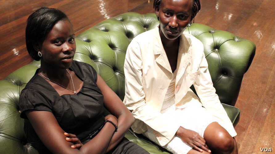 19 year-old Proscovia Alengot Oromait (left), Africa's youngest MP, with her sister in Kampala on September 21. (Hilary Heuler/VOA News)