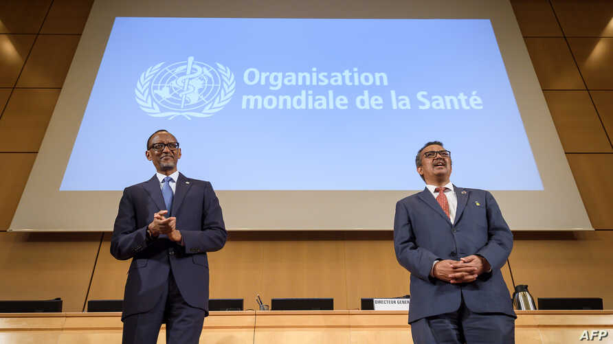 Rwandan President Paul Kagame (L) and World Health Organization (WHO) Director-General Tedros Adhanom Ghebreyesus attends the opening day of the World Health Assembly, an annual meeting with health representatives to discuss a range of global health