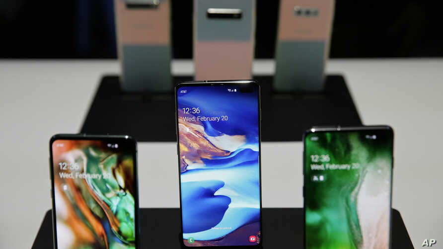 The new Samsung S10 phones are displayed Feb. 20, 2019, in San Francisco. Samsung is hailing the 10th anniversary of its first smartphone with three new models that it hopes reverses a sales slump in an industry recycling the same ideas.