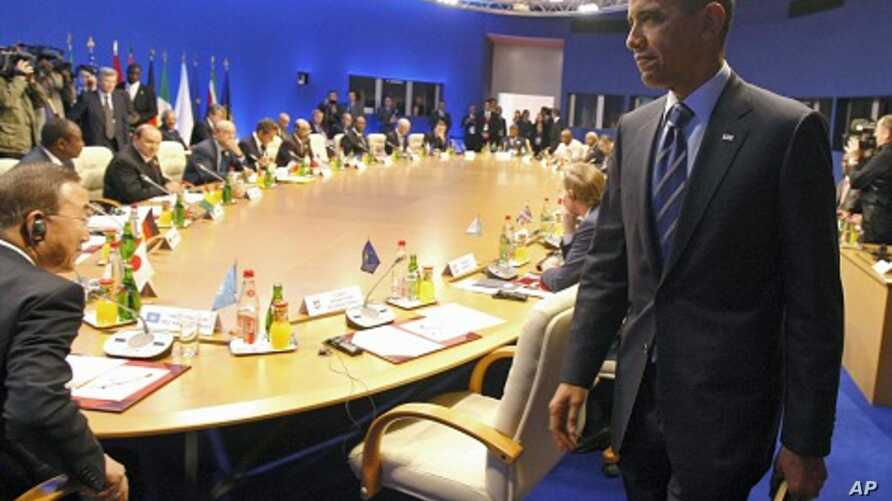 U.S. President Obama takes his seat for a round table meeting between G8 members and African countries at the G8 summit in Deauville, May 27, 2011