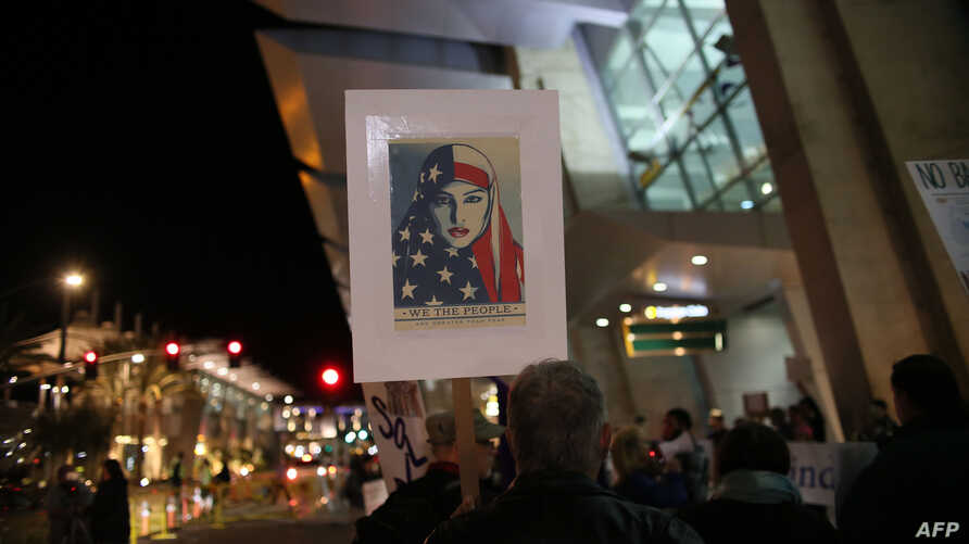 Protesters chant during a rally against the travel ban at San Diego International Airport on March 6, 2017 in San Diego.
