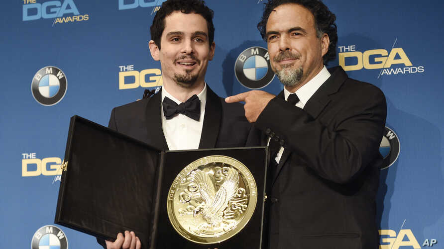 """Damien Chazelle, left, director of """"La La Land,"""" celebrates his Feature Film Award win with presenter Alejandro Gonzalez Inarritu backstage at the 69th Annual Directors Guild of America Awards at the Beverly Hilton, Feb. 4, 2017, in Beverly Hills, Ca"""