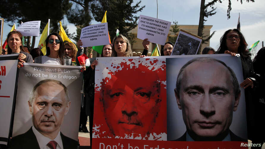 Kurds living in Cyprus shout slogans during a demonstration against the Turkish offensive on Kurdish forces in northwest Syria, March 1, 2018, outside the Russian Embassy in Nicosia, Cyprus.