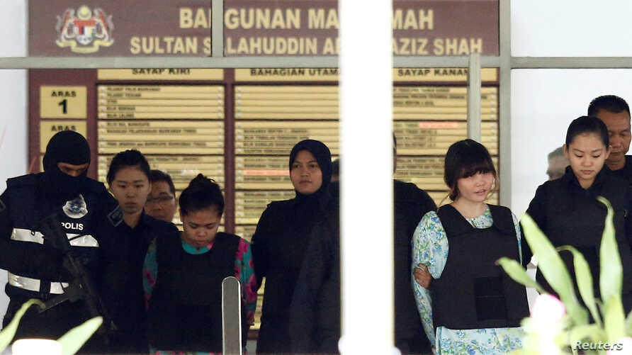 Vietnamese Doan Thi Huong and Indonesian Siti Aisyah who are on trial for the killing of Kim Jong Nam, the estranged half-brother of North Korea's leader, are escorted as they leave the Shah Alam High Court on the outskirts of Kuala Lumpur, Malaysia,...