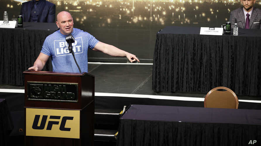 UFC president Dana White speaks beside an empty chair where Conor McGregor was supposed to sit during a news conference in Las Vegas for UFC 200, April 22, 2016.