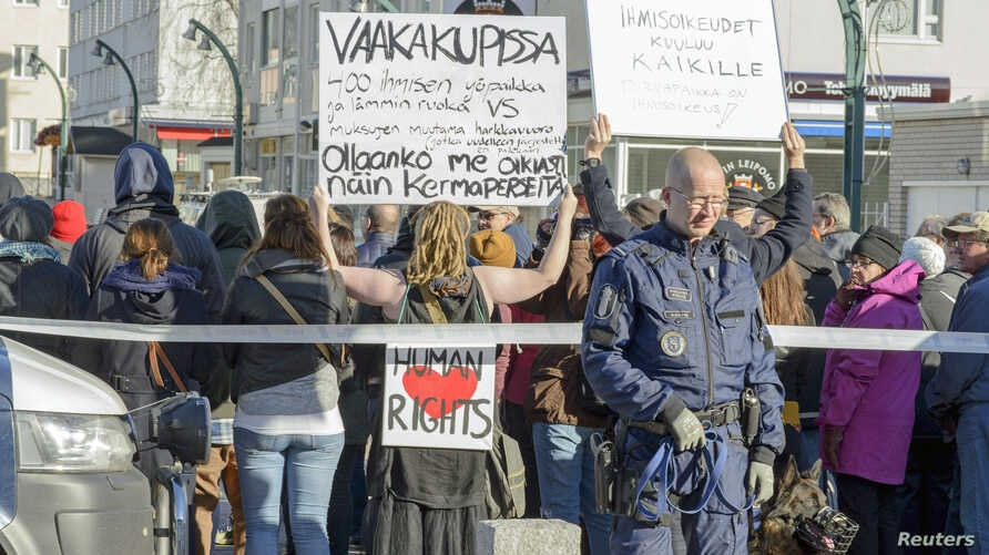 Both pro-immigration and anti-immigration protesters shout slogans in Tornio, Finland, Oct. 3, 2015.