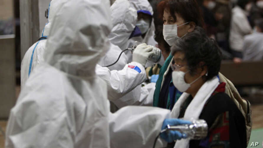 Evacuees are screened for radiation contamination at a testing center Tuesday, March 15, 2011, in Koriyama city, Fukushima Prefecture, northern Japan, four days after a massive earthquake and tsunami struck the country's north east coast.