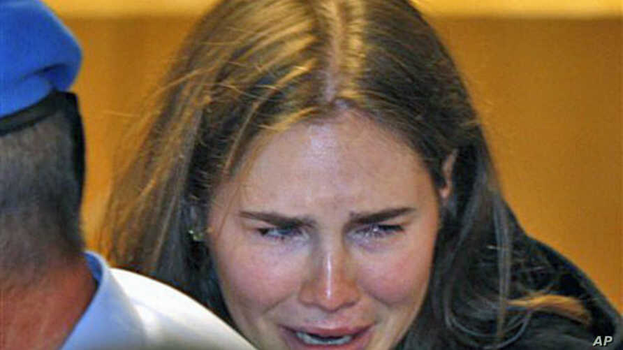 Amanda Knox breaks down in tears after hearing the verdict that overturns her conviction and acquits her of murdering her British roommate Meredith Kercher, at the Perugia court, central Italy, October 3, 2011.