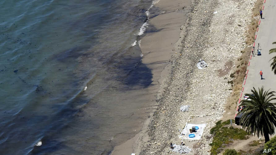 Clean-up crews work at the site of an oil spill at Refugio State Beach, north of Goleta, Calif., Wednesday, May 20, 2015.