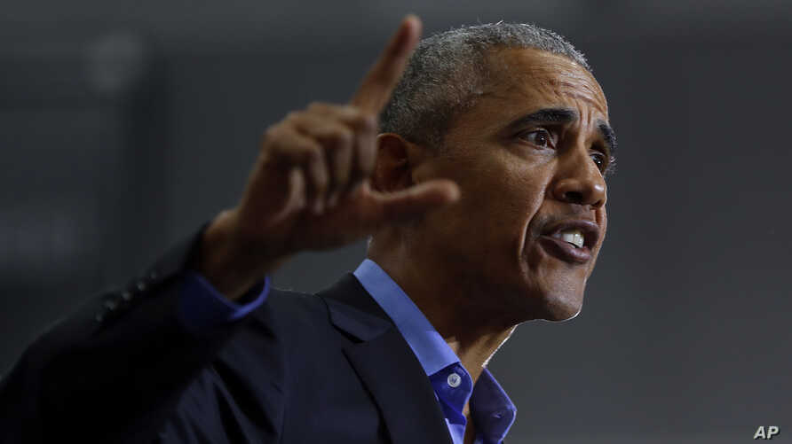 Former President Barack Obama, making a pitch for Democratic votes in the midterm elections, speaks during a rally in Detroit, Oct. 26, 2018.