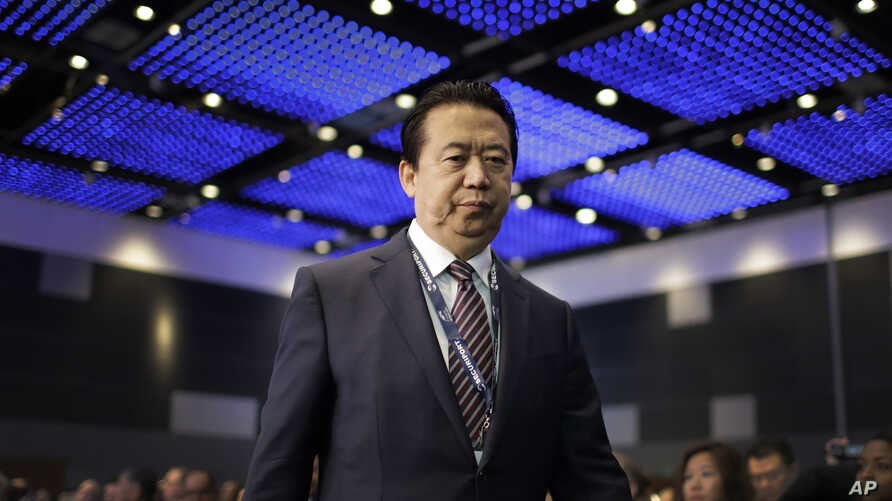 FILE - Interpol President Meng Hongwei walks toward the stage to address the Interpol World Congress in Singapore, July 4, 2017.