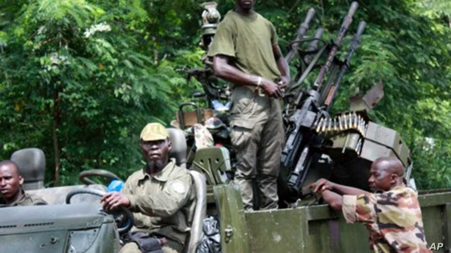 Members of Pro-Ouattara forces hold their weapons on March 29, 2011 in Duekoue, in western Ivory Coast