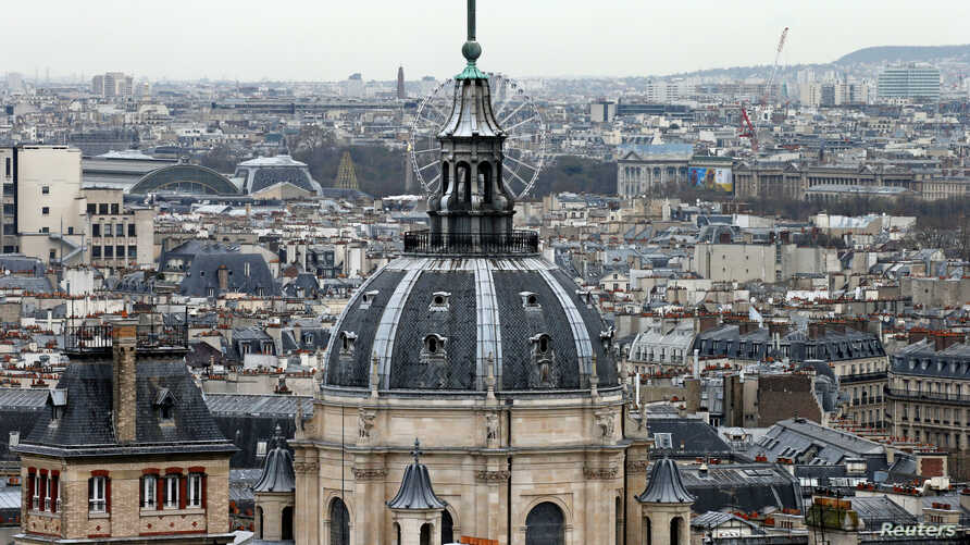 FILE PHFILE - A city view shows the dome at La Sorbonne University as part of the skyline in Paris, France, March 30, 2016.