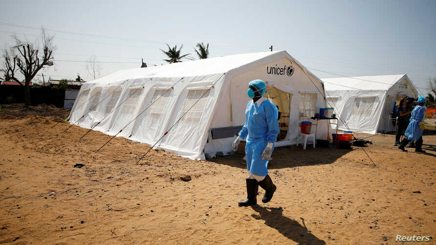 Medical staff wear protective masks at a cholera treatment center set up in the aftermath of Cyclone Idai in Beira, Mozambique, March 29, 2019.