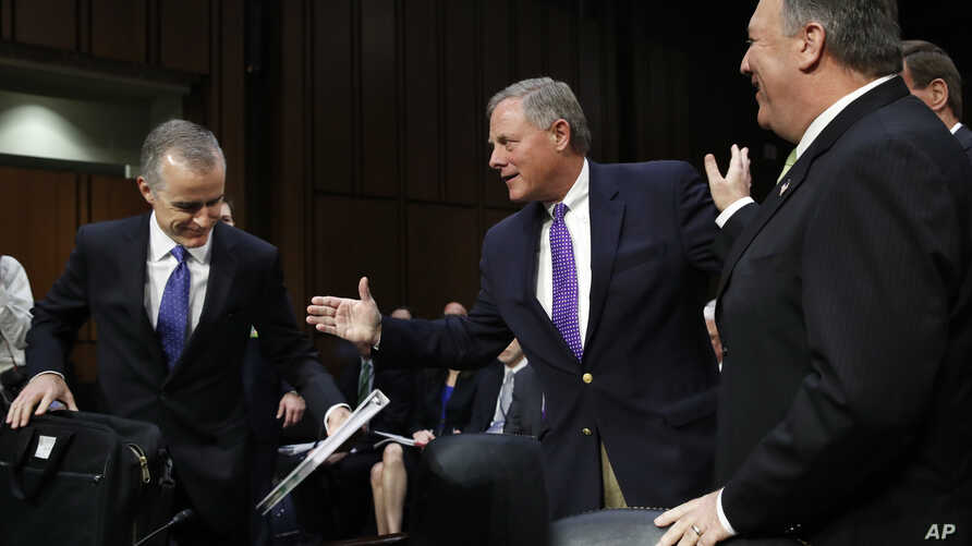 Acting FBI Director Andrew McCabe, left, is greeted on Capitol Hill, May 11, 2017, by Senate Intelligence Committee Chairman Sen. Richard Burr, R-N.C., next to CIA Director Mike Pompeo prior to a hearing on major threats facing the U.S.