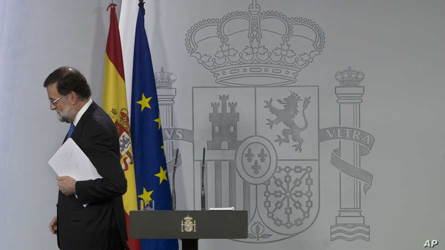 Spain's Prime Minister Mariano Rajoy leaves after a news conference in Madrid, Spain, Dec. 22, 2017.
