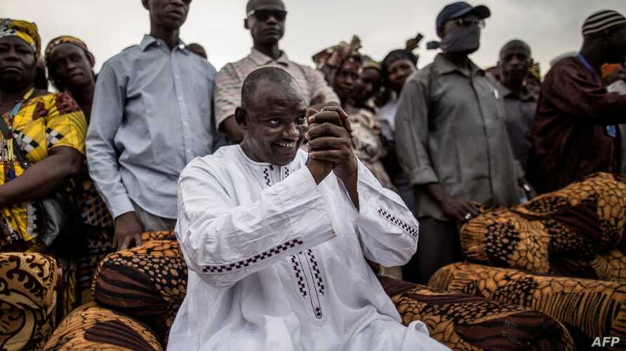 Adama Barrow, the flag-bearer of the coalition of the seven opposition political parties in Gambia, greets supporters during a gathering in the Buffer Zone district of Talinding, Nov. 29, 2016, on the last day of the presidential campaign in Gambia.
