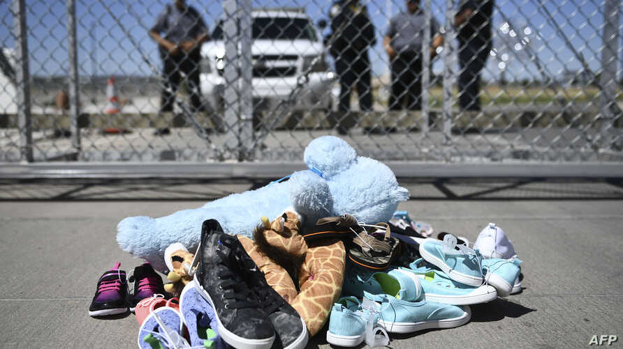Shoes are left by people at the Tornillo Port of Entry near El Paso, Texas during a protest rally by several American mayors against the US administration's family separation policy.