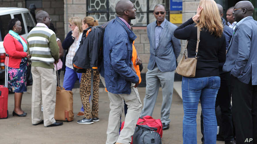 FILE - Aid workers from various NGOs active in South Sudan arrive at Wilson airport in Nairobi, Kenya, July 13, 2016, from Juba.