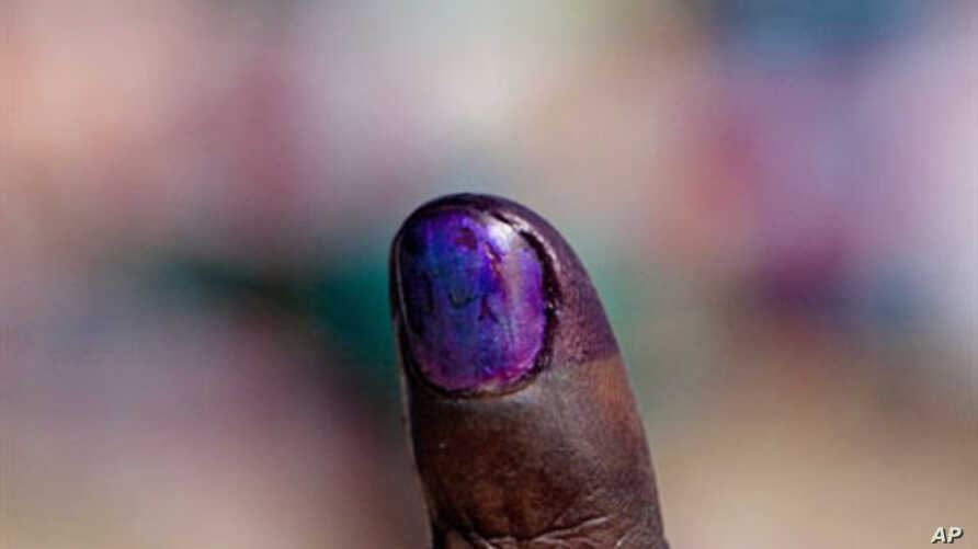 A Sudanese voter shows the purple ink on his index finger after casting his vote in the week-long independence referendum expected to lead to the partition of Africa's largest nation, 09 Jan 2011